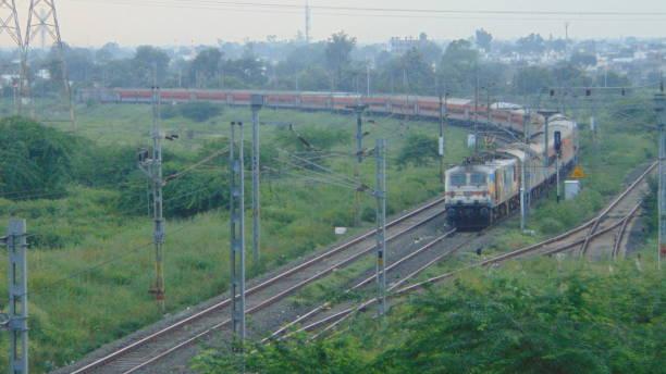 Train on curve Tata Steel Livery WAP7 37026 Hauled 12859 Mumbai CSMT Howrah Geetanjali SF Express stock photo