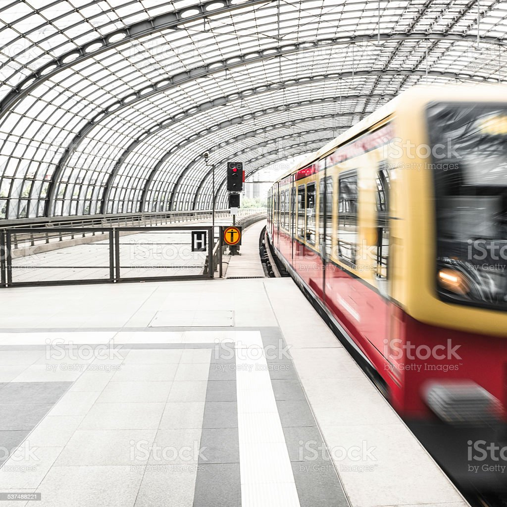 train on motion on a futuristic station stock photo