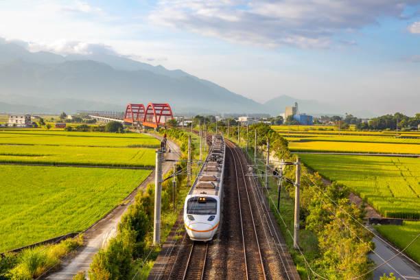 train on the field in yuli, hualien stock photo