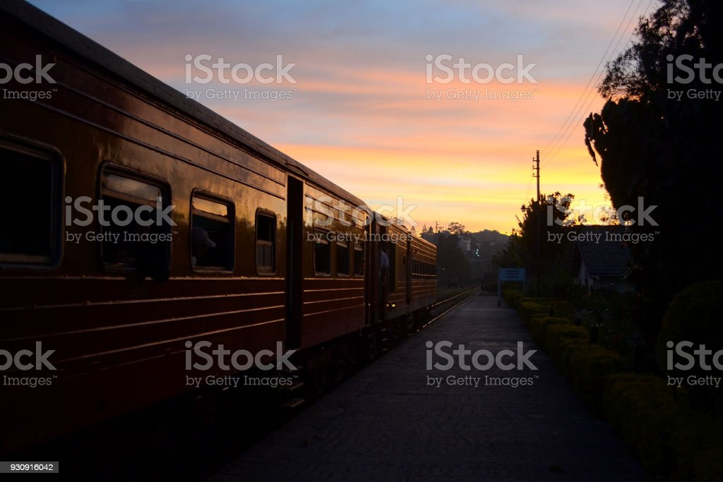 Train on the railroad station on sunset stock photo