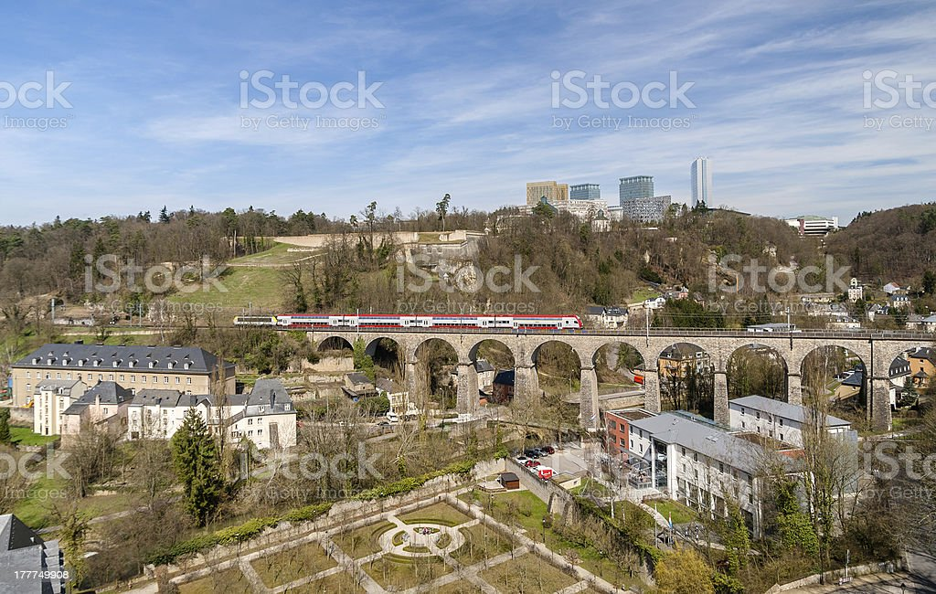 Train on viaduct in Luxembourg against background of European organisations royalty-free stock photo