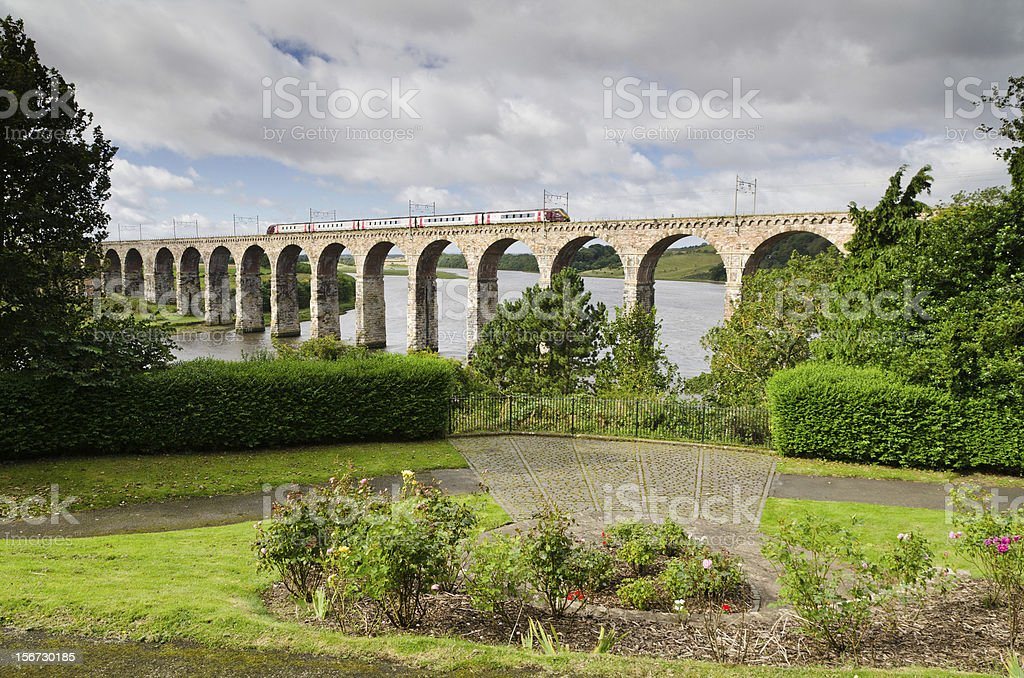 Train on viaduct stock photo