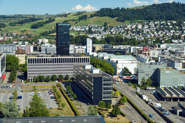 Zug Panorama Zug (Switzerland) panoramic view with office buildings, homes and a hill in the yard. zug stock pictures, royalty-free photos & images