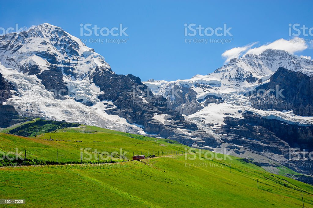 Train pass by Jungfrau, Switzerland royalty-free stock photo