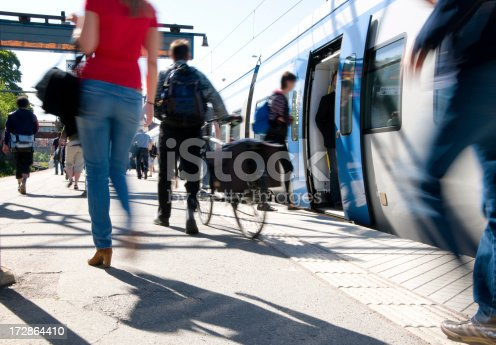 istock Train passengers entering commuter carriage 172864410