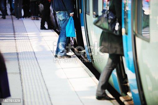 172864410istockphoto Train passengers entering commuter carriage 182761329