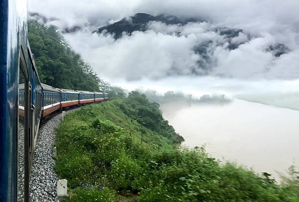 train passing a beautiful fog mountains and  river - sa pa zdjęcia i obrazy z banku zdjęć