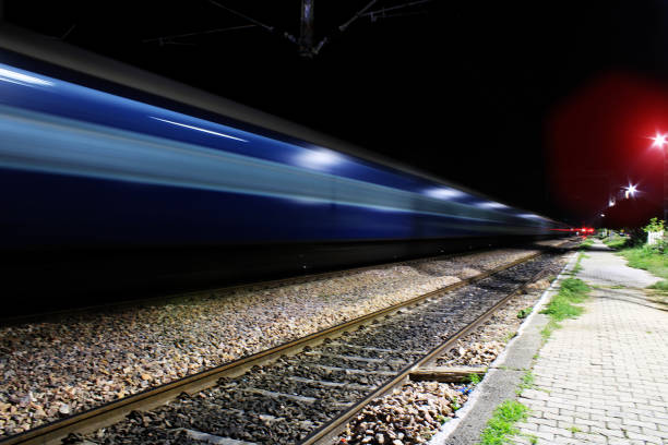 Train passing at night Train passing at night electric train stock pictures, royalty-free photos & images