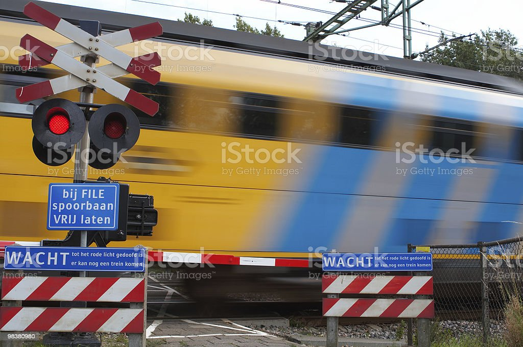Train passing crossing royalty-free stock photo