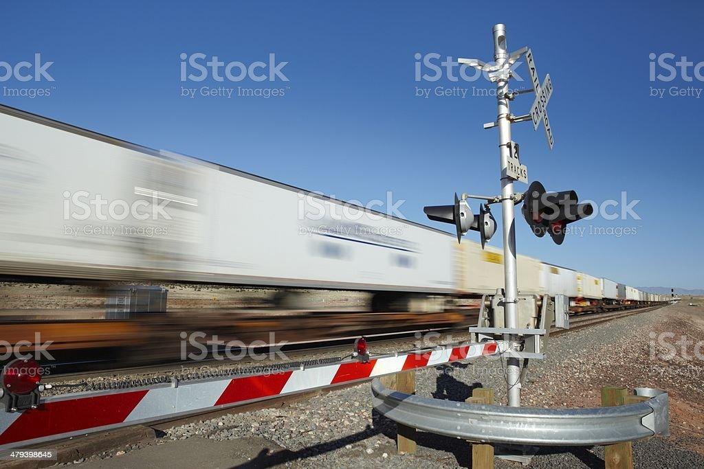 Train passing level crossing motion blur stock photo
