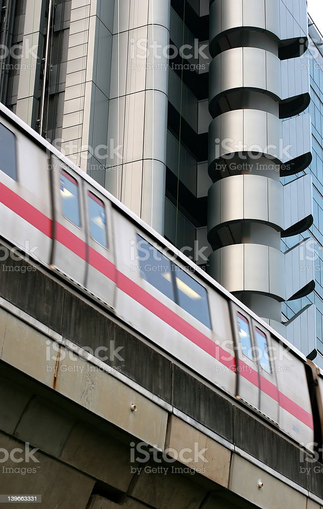 train passing modern building royalty-free stock photo