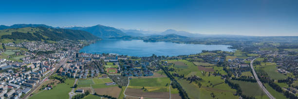 Zug Aerial of Zug with the Alps in the background zug stock pictures, royalty-free photos & images