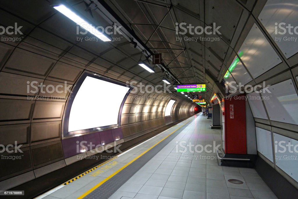 Train platform with advertising boards stock photo