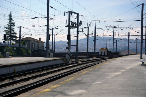 Train platform,tracks,electrical wires. stock photo