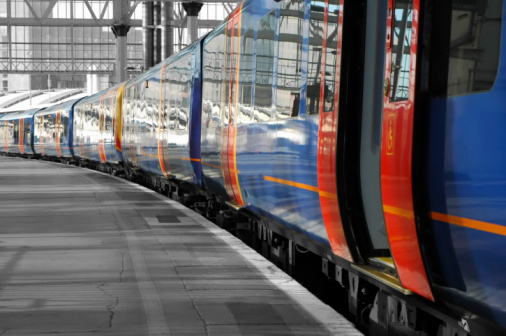 Color desaturation abstract of commuter train on an empty station platform.