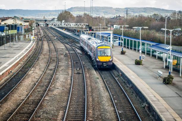 Train Pulling Upto A Station Platform stock photo