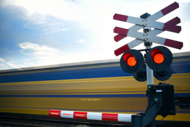 Train railroad crossing with passing high speed riding train stock photo