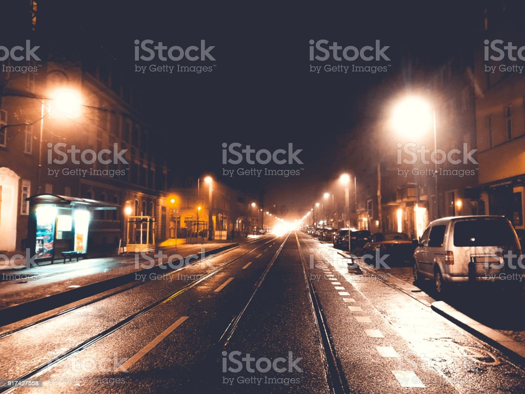 train rails in a street at night stock photo
