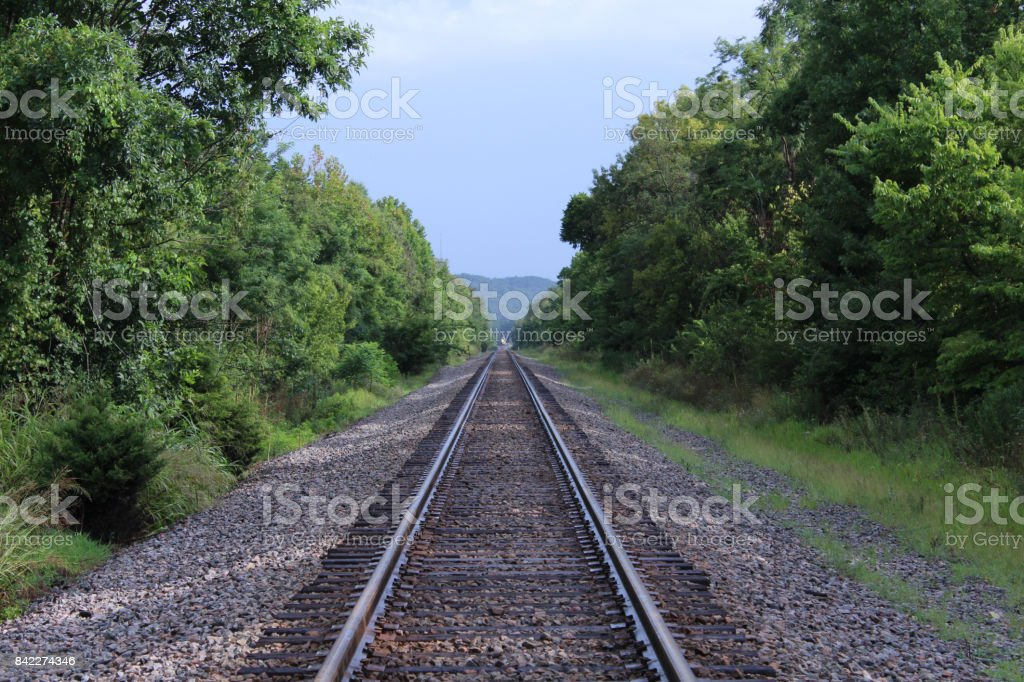 Train Railway Tracks Fading Off Into the Far Distance stock photo