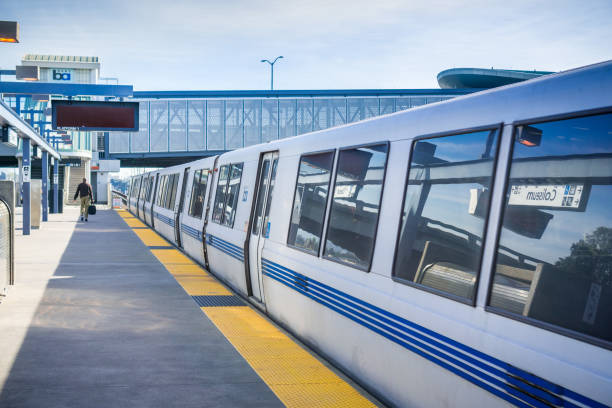 BART train ready to depart the station November 19, 2017 Oakland/CA/USA - BART train ready to depart from Coliseum BART stop, east San Francisco bay area depart stock pictures, royalty-free photos & images