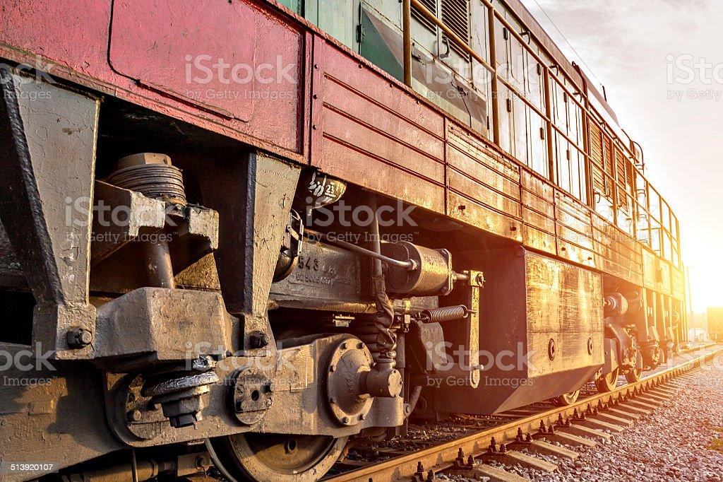 Train running in sunset stock photo
