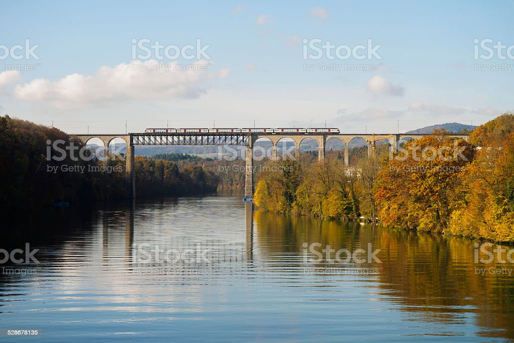 Train running over Rhine river stock photo