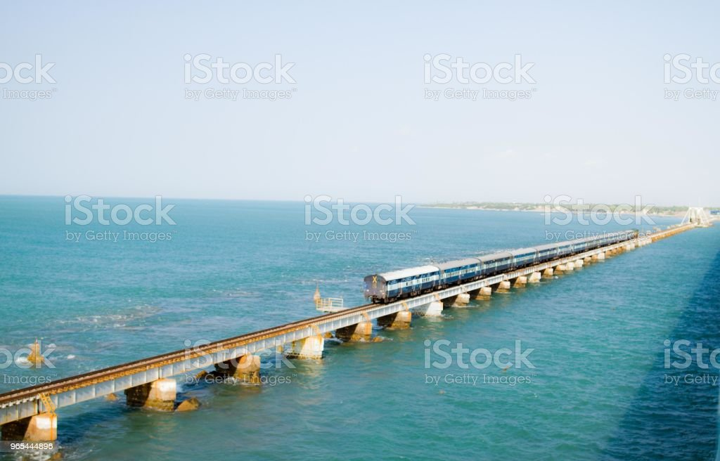 Train seen on Pamban bridge over water royalty-free stock photo