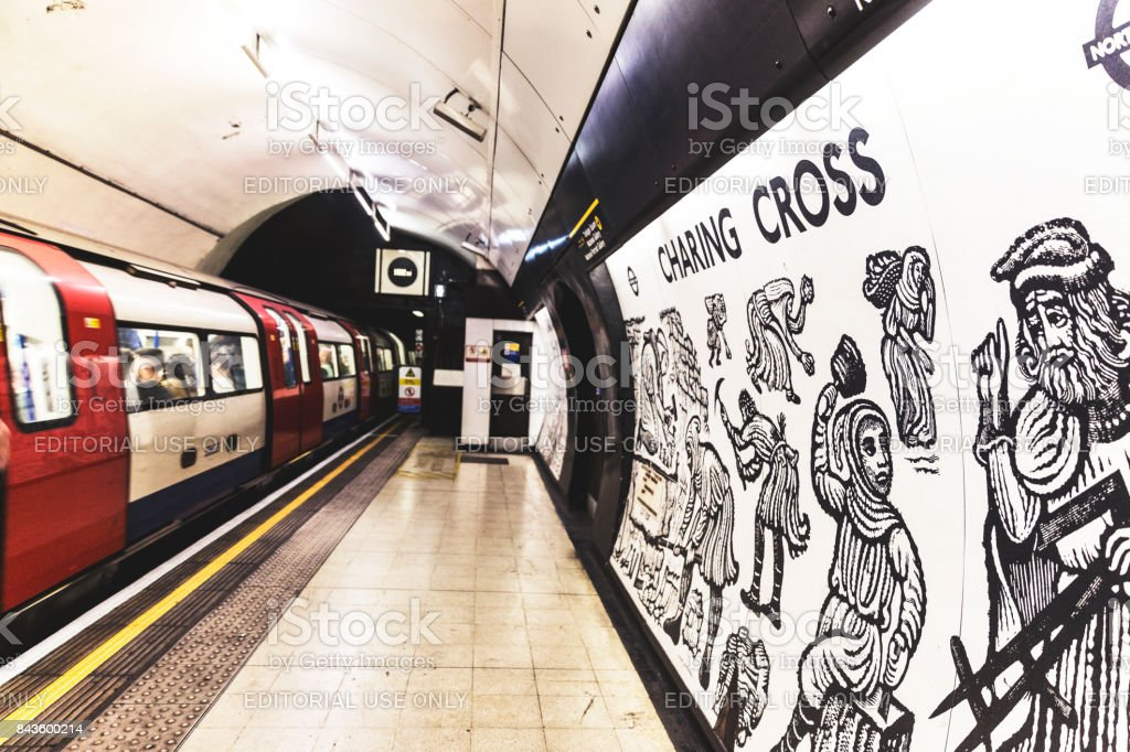 Train slowing down at Charing Cross station stock photo