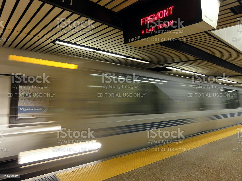 BART Train speeds into station platform stock photo
