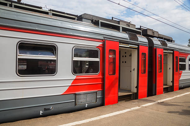 RZD train standing at platform Dmitrov, Moscow, Russia - July 18, 2015: Under the control of the government and the President of Russia held on the situation in the direction of the suburban railway transport. electric train stock pictures, royalty-free photos & images