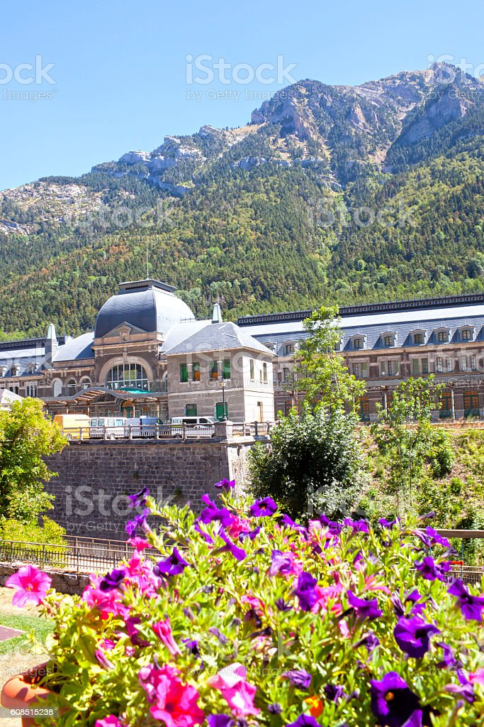 train station in front of some purpple flowers, Canfranc, Spain stock photo