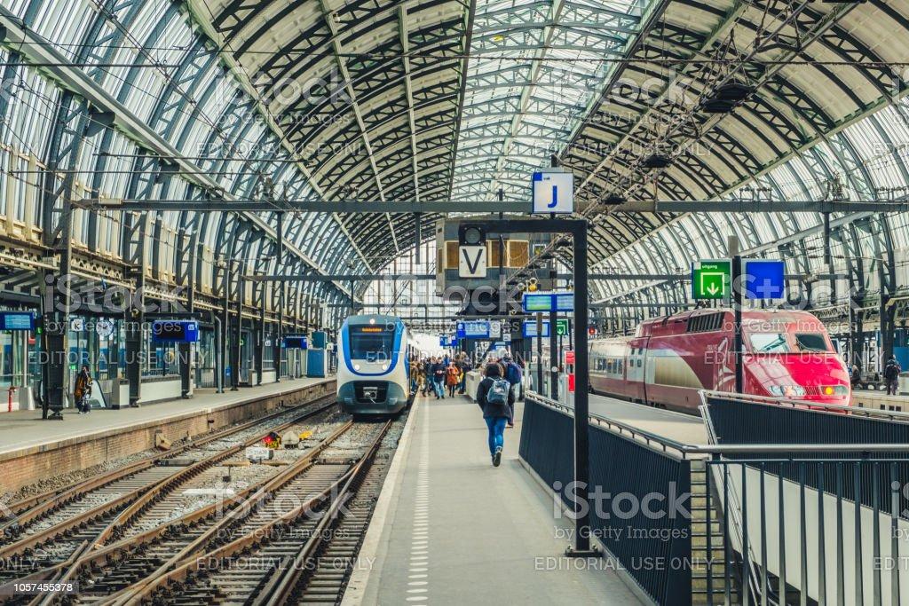 Train station platform at Amsterdam Central station .