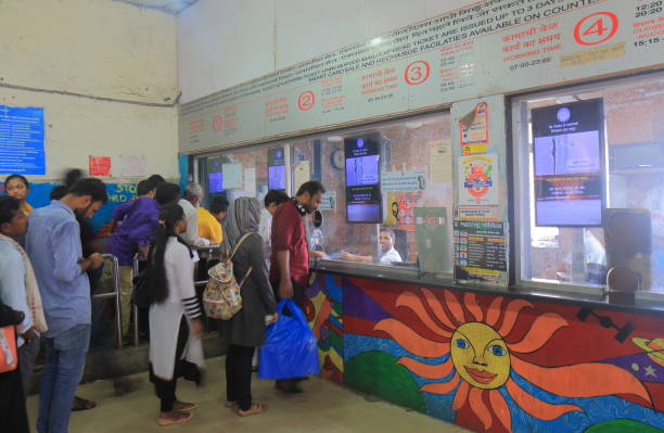 Train station ticket counter Mumbai India Mumbai India - October 14, 2017: People buy train tickets at Sandhurst Road train station in downtown Mumbai. admit stock pictures, royalty-free photos & images