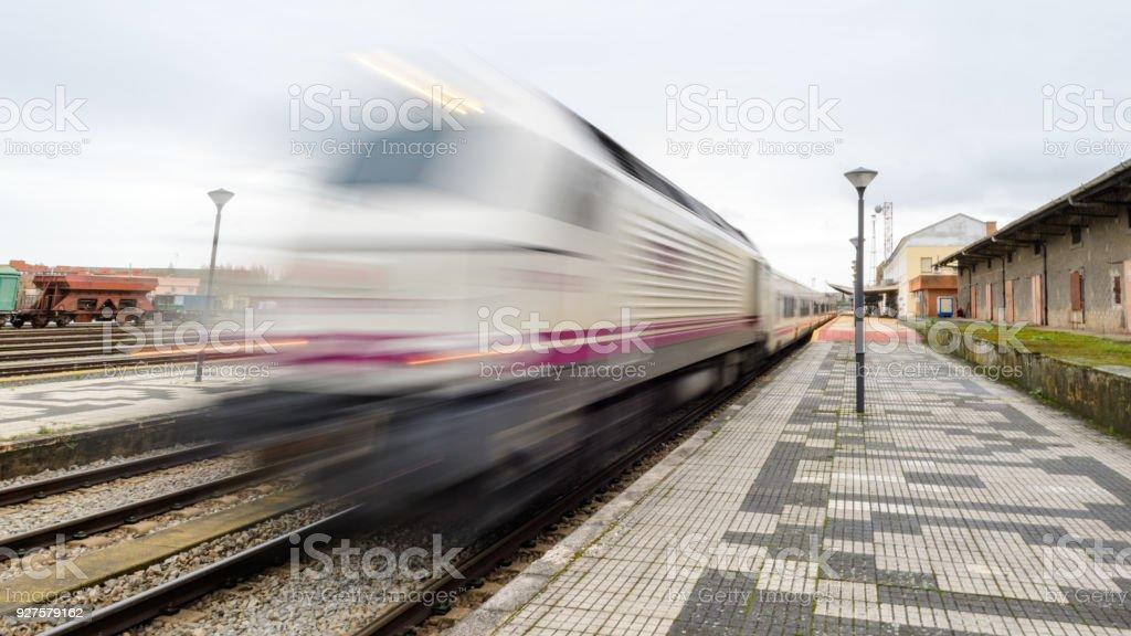 train talgo train station leaving at high speed, sensation of movement stock photo