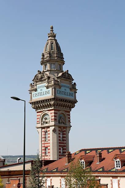 Train Tower in Champagne Region of France, Europe Wine Country The Champagne region of France, a wine grape growing region famous for its champagne products.  Train station tower in the center of town of Epernay. epernay stock pictures, royalty-free photos & images