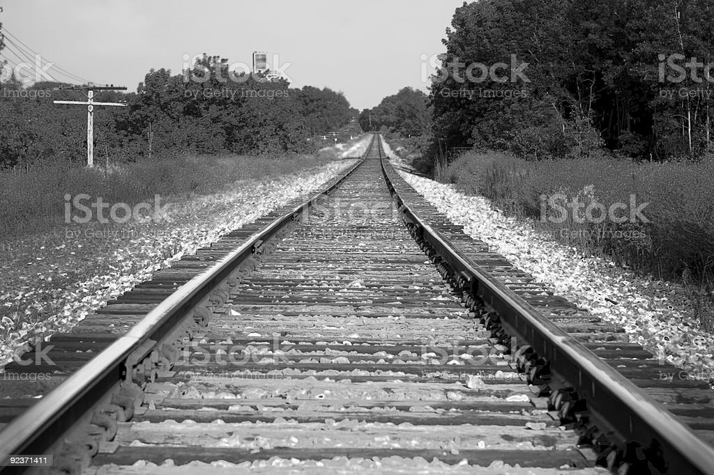 Train tracks in black and white royalty-free stock photo