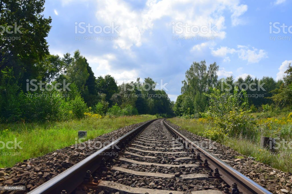 Train tracks seen from a close distance with all the rubble and...