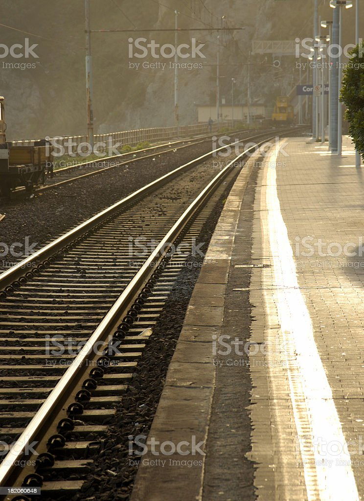 Train tracks with sunlight highlighting the rails stock photo