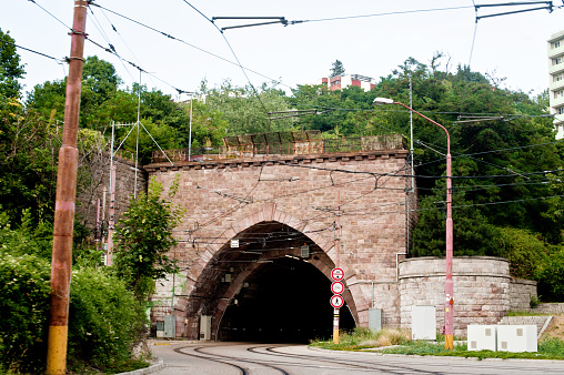 Train / Tram Tracks & Road Through A Tunnel