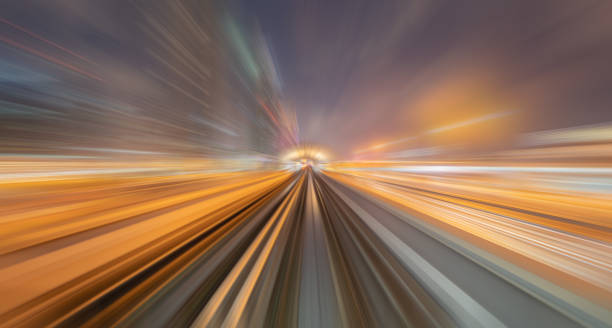 Train view. blurry speed motion on railway tunnel for futuristic network connection technology, digital data in computer concept. Abstract background at night time. stock photo