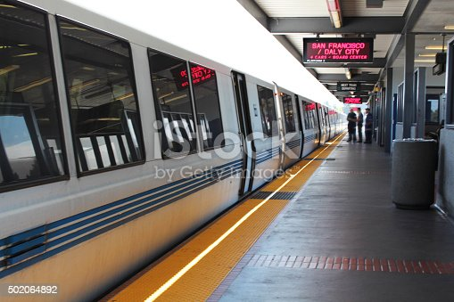 BART, the popular Bay Area Rapid Transit, metro train at a train station. The train has handicap access.