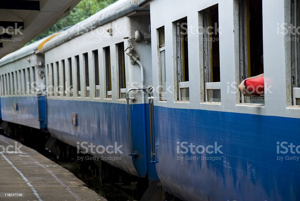 Train waiting to depart station in Thailand stock photo