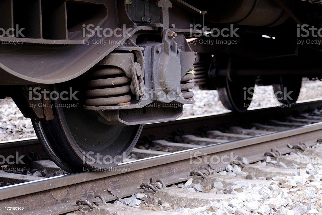 Train wheels arranged as a bogie on railway track stock photo