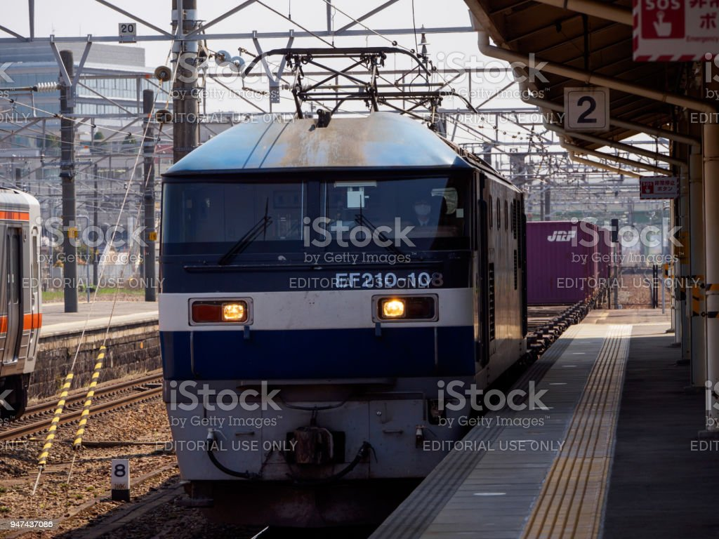 Train with shipping containers stops at Atsuta Station, Nagoya, Japan stock photo