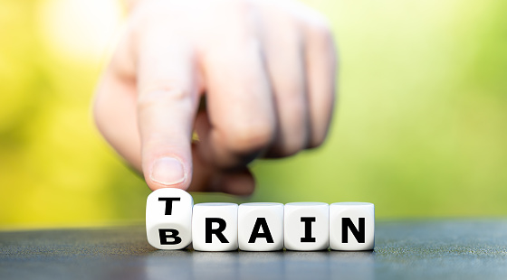 Train your brain. Dice form the words train and brain.