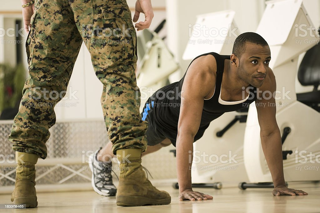 Trainee Doing Burpees at a Fitness Bootcamp royalty-free stock photo