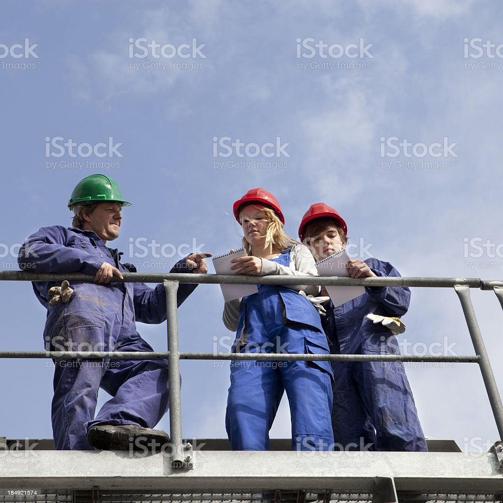 Trainee engineer learning their trade royalty-free stock photo