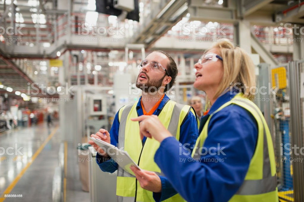 Trainee Factory Worker in Action stock photo