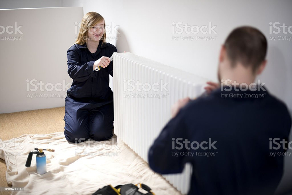 trainee female plumber royalty-free stock photo