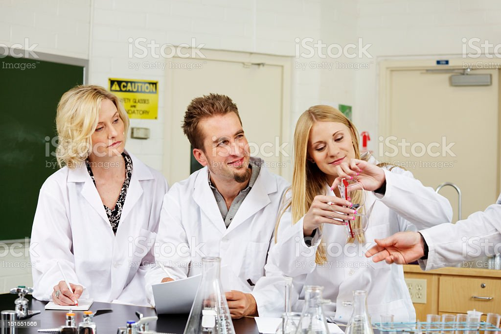 Trainee lab workers learning stock photo